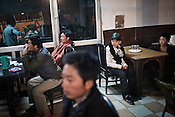 Newly arrived Tibetan refugees wait for dinner at a local restaurant enroute from Delhi to the Tibetan Reception Centre in Dharamsala, Himachal Pradesh, India. Photo: Sanjit Das/Panos