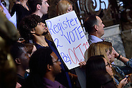 Philadelphia, PA - September 27, 2016: A man holds a sign urging voter registration during a campaign stop to support Hillary Clinton's presidential campaign at Drexel University in Philadelphia, Pennsylvania, September 27, 2016.  (Photo by Don Baxter/Media Images International)