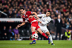 """Carlos Henrique Casemiro (r) of Real Madrid battles for the ball with Paulo Henrique Chagas de Lima """"Ganso"""" of Sevilla FC during their Copa del Rey Round of 16 match between Real Madrid and Sevilla FC at the Santiago Bernabeu Stadium on 04 January 2017 in Madrid, Spain. Photo by Diego Gonzalez Souto / Power Sport Images"""