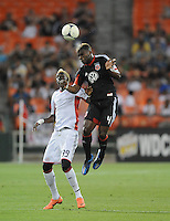D.C. United defender Brandon McDonald (4) heads the ball against New England Revolution forward Saer Sene (39) D.C. United defeated The New England Revolution 3-2 at RFK Stadium, Saturday May 26, 2012.
