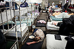 An overflow crowd of homeless men take up every cot and use mats on the floor to sleep at Stockton's Shelter for the Homeless, July 18, 2012. With some of the highest rates of unemployment and home foreclosures in the country, Stockton, the largest US city to declare bankruptcy, is grappling with large numbers of homeless.