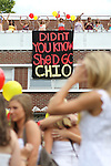 Chi Omega sorority members cheer on a balcony when their sorority pledges arrive during the 2011 sorority bid day event on Thursday, August 18, 2011. Photo by Brandon Goodwin | Staff