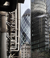 The Swiss Re building, known as the Gherkin, 1997 -  2004, Foster and Partners, Arup Engineering, London, UK. Willis Building on the right and Lloyds building on the left. Picture by Manuel Cohen