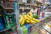 """A display of fresh fruits and vegetables, surrounded by unhealthy snacks, in the Makey Deli in the South Bronx in New York on Thursday, September 19, 2013. A program of City Harvest and Ironwill, """"Healthy Neighborhoods""""  endeavors to improve access to fruits and vegetables in neighborhoods that are """"food deserts"""", providing the primarily low income residents with access to affordable healthy food choices. (© Richard B. Levine)"""