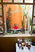 Portrait of Mexican cinematographer Alexis Zabe in his Mexico City home.  Mexico DF