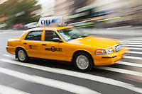 Motion blurred abstraction of taxi rushing through the streets of New York City