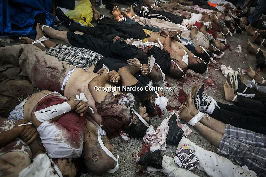 In this Wednesday, Aug. 14, 2013 photo, dead bodies lay down on the floor of the field hospital during clashes between supporters of the ousted president Mohammed Morsi with security forces in streets around Al-Raba'a Alawya mosque in the Nasr district of Cairo. (Photo/Narciso Contreras).