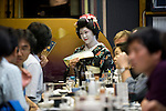 """Customers enjoy dinner and a chat with a geisha aboard a """"Yakata-bune"""" pleasure boat run by Harumiya Co. in Tokyo, Japan on 30 August  2010. .Photographer: Robert Gilhooly"""