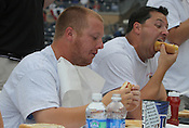 "Matt Zeblo and Mark Thomas devour hotdogs during the Bright Leaf Hot Dog Eating Contest on Sunday, July 3, 2011. ""I've been training for this all my life,"" said Thomas."