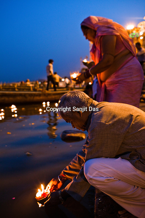 Hindu pilgrims offer lamps in the river Ganges at the Dashashwamedh Ghat in the ancient city of Varanasi in Uttar Pradesh, India. Photograph: Sanjit Das/Panos