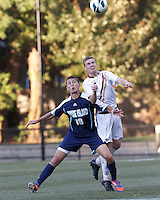 University of Rhode Island (URI) midfielder Mike Casey (18) and Boston College midfielder Jason Abbott (6) battle for head ball. Boston College defeated University of Rhode Island, 4-2, at Newton Campus Field, September 25, 2012.