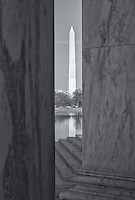 The Washington Monument seen through the pillars of the Jefferson Memorial in afternoon light