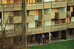 Youths drug dealing in run down council estate high rise apartment block. Moss Side, near Manchester England.