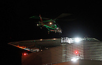 The Pegasus helicopter lands with a patient on top of the hospital at the University of Virginia Medical center. Photo/Andrew Shurtleff