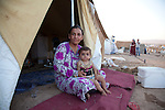 DOMIZ, IRAQ: A mother and child in the Domiz refugee camp..Over 7,000 Syrian Kurds have fled the violence in Syria and are living in the Domiz refugee camp in the semi-autonomous region of Iraqi Kurdistan...Photo by Ali Arkady/Metrography
