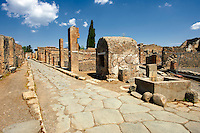 Roman road of Via Consolare , Pompeii, with a well and a surgeons house.