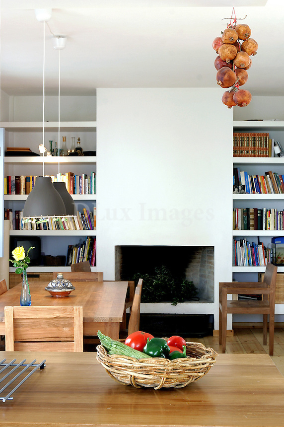 living room with dining set and fireplace