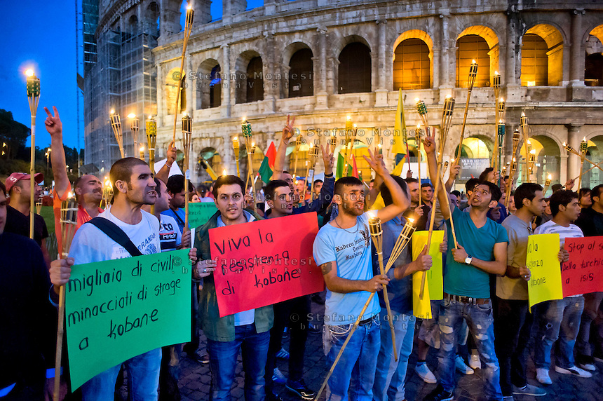 Roma 8  Ottobre 2014<br /> Manifestazione delle associazioni dei curdi a Roma al Colosseo per &laquo;salvare la citt&agrave; di Kobane, dall'avanzata dell'Isis&raquo;. La marcia di solidariet&agrave; al popolo curdo sostiene la resistenza di Kobane, la citt&agrave; a nord della Siria al confine con la Turchia sulla quale procede  l'avanzata dell'Isis.<br /> Rome October 8, 2014 <br /> Demostration of Kurdish Associations in Rome  at the Colosseum  to &quot;save the city of Kobane, by the advance of the Isis.&quot; The march of solidarity with the Kurdish people support the resistance of Kobane, the city in northern Syria on the border with Turkey on which proceeds  the advance  of the  Isis.