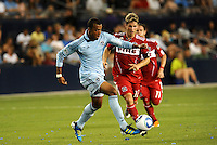 Teal Bunbury (blue) KC,Logan Pause (12) Chicago...Sporting KC and Chicago Fire played to a scoreless tie in the inaugural game at LIVESTRONG Sporting Park, Kansas City, Kansas.