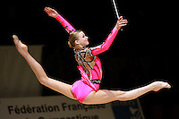 Olga Kapranova of Russia split leaps to re-catch ribbon during event finals at 2006 Thiais Grand Prix in Paris, France on March 26, 2006.  (Photo by Tom Theobald)
