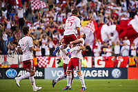Brandon Barklage (25) of the New York Red Bulls celebrates scoring with Dax McCarty (11), Connor Lade (16), and Heath Pearce (3).  The New York Red Bulls defeated DC United 3-2 during a Major League Soccer (MLS) match at Red Bull Arena in Harrison, NJ, on June 24, 2012.