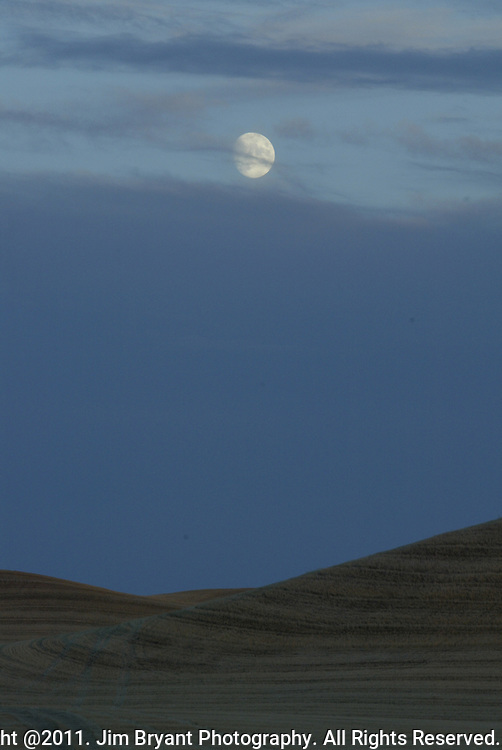 The moon rises above freshly cut wheat fields in the Palouse of Eastern Washington. Jim Bryant Photo. ©2011. All Rights Reserved.