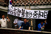 Seoul, South Korea<br /> June 24, 1987<br /> <br /> Kim Dea-jong (trimming tree) in his backyard under house arrest as opposition leader to the ruling party. <br /> <br /> <br /> Kim Dae-jung (3 December 1925 to 18 August 2009) was President of South Korea from 1998 to 2003, and the 2000 Nobel Peace Prize recipient. As of this date Kim is the first and only Nobel laureate to hail from Korea. A Roman Catholic since 1957, he has been called the &quot;Nelson Mandela of Asia&quot; for his long-standing opposition to authoritarian rule.