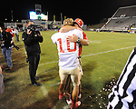 Lafayette High's Colby Terrell (10) hugs Lafayette High head coach Anthony Hart vs. Laurel in the MHSAA Class 4A championship game at Mississippi Veterans Memorial Stadium in Jackson, Miss. on Saturday, December 3, 2011. Lafayette won 39-29, the team's 32 straight win, to capture their second consecutive state championship.