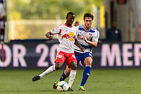 Bradley Wright-Phillips (99) of the New York Red Bulls is marked by George John (14) of FC Dallas. The New York Red Bulls defeated FC Dallas 1-0 during a Major League Soccer (MLS) match at Red Bull Arena in Harrison, NJ, on September 22, 2013.