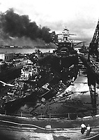 Japanese attack on Pearl Harbor.  Wrecked USS DOWNES at left and USS CASSIN at right.  In the rear is the USS PENNSYLVANIA, 33,100-ton Flagship of the Pacific Fleet, which suffered only light damage.  December 1941.  Attributed to CPhoM.H.S. Fawcett.  (Navy)<br /> Exact Date Shot Unknown<br /> NARA FILE #:  080-G-19943<br /> WAR &amp; CONFLICT BOOK #:  1138
