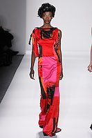 Model walks runway in a brilliant brush strokes silk satin draped column gown w/draped jet beads necklace + tassels, from the Zang Toi Fall 2012 &quot;Glamour At Gstaad&quot; collection, during Mercedes-Benz Fashion Week New York Fall 2012 at Lincoln Center.