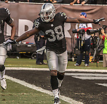 Oakland Raiders strong safety T.J. Carrie (38) happy about breaking up pass play on Sunday, December 04, 2016, at O.co Coliseum in Oakland, California.  The Raiders defeated the Bills 38-24.