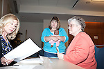 March 11, 2010. Raleigh, North Carolina.. The first N.C. Poverty Simulation Experience training session was held at the 40th Annual State Head Start Conference at the Raleigh Convention Center.  . Nearly 60 individuals, including staff and parents from Head Start programs and Community Action Agencies, engaged in role playing exercises that hoped to simulate the experience of being poor and what the poor go through on a daily basis.. Mother, right, and baby at Interfaith Services.