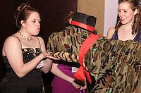 WSU freshman Madeleine Casto (left) puckers up as if to kiss Fredrick the Dinosaur (aka sophomore Alex Goodman) at the 2008 Arts Gala at Wright State University, Saturday, April 5, 2008.