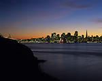 San Francisco skyline at sunset with city lights in bay from Treasure Island, San Francisco, California USA