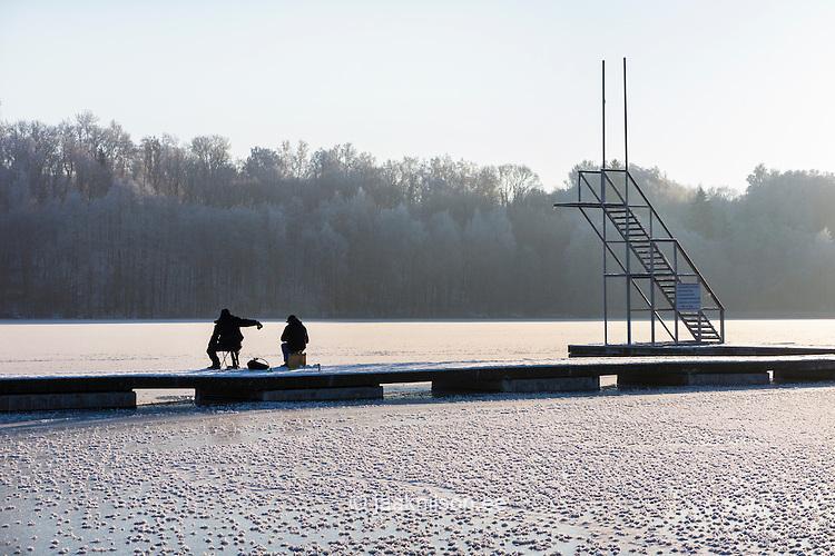 Jn jaak nilson photostock for Frozen fishing pole