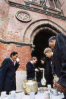 People drink tea after the Sunday service at the Christian Cathedral in Lahore.