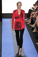 Sara walks runway in a magenta faille trench jacket with blocked lace detail, and carbon black stretch wool pant, by Monique Lhuillier, from the Monique Lhuillier Spring 2012 collection fashion show, during Mercedes-Benz Fashion Week Spring 2012.