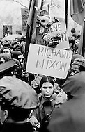 New York City, NY - April 8, 1969 <br /> A woman holds up a real pig&rsquo;s head attached to a sign reading: &lsquo;Richard Nixon&rsquo; during a protest against the Vietnam War. During April 1969 the war crossed a sad milestone, claiming more soldiers' lives than that of the entire Korean War.  I will never see real pig heads used again in any other demonstration.<br /> New York City, NY. 8 avril 1969. <br /> Les hippies manifestent contre l&rsquo;escalade de la guerre au Vietnam. Nixon est le premier vis&eacute;. De vraies t&ecirc;tes de cochons seront plant&eacute;es sur des piquets. Ce sera la seule fois o&ugrave; je verrai de vraies t&ecirc;tes de cochons utilis&eacute;es pendant des d&eacute;monstrations.