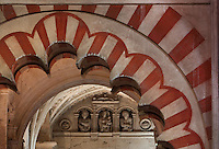 Detail of a fluted arch with red and white painted stripes, in the area built under Prince Abd Al-Rahman II, begun 832, in the Cathedral-Great Mosque of Cordoba, in Cordoba, Andalusia, Southern Spain. The first church built here by the Visigoths in the 7th century was split in half by the Moors, becoming half church, half mosque. In 784, the Great Mosque of Cordoba was begun in its place and developed over 200 years, but in 1236 it was converted into a catholic church, with a Renaissance cathedral nave built in the 16th century. The historic centre of Cordoba is listed as a UNESCO World Heritage Site. Picture by Manuel Cohen