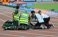 An athlete requires attention at the Sainsbury Anniversary Games, Olympic Stadium, London England,Saturday 27th July 2013-Copyright owned by Jeff Thomas Photography-www.jaypics.photoshelter.com-07837 386244. No pictures must be copied or downloaded without the authorisation of the copyright owner.