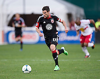 Chris Pontius (13) of D.C. United brings the ball upfield during the game at RFK Stadium in Washington, DC.  New York Red Bulls defeated D.C. United, 2-0.