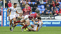 Wigan Warriors' Tony Clubb is tackled by Huddersfield Giants' Oliver Roberts <br /> <br /> Photographer Stephen White/CameraSport<br /> <br /> Betfred Super League Round 5 - Wigan Warriors v Huddersfield Giants - Sunday 19th March 2017 - DW Stadium - Wigan<br /> <br /> World Copyright &copy; 2017 CameraSport. All rights reserved. 43 Linden Ave. Countesthorpe. Leicester. England. LE8 5PG - Tel: +44 (0) 116 277 4147 - admin@camerasport.com - www.camerasport.com