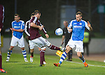 St Johnstone v Hearts..15.12.12      SPL.Rowan Vine takes a sore one from Andy Webster.Picture by Graeme Hart..Copyright Perthshire Picture Agency.Tel: 01738 623350  Mobile: 07990 594431