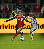 13 April 2011: Los Angeles Galaxy midfielder Juninho #19 and Toronto FC defender Dan Gargan #8 in action during an MLS game between Los Angeles Galaxy and the Toronto FC at BMO Field in Toronto, Ontario Canada..The game ended in a 0-0 draw.