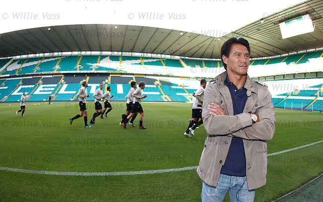 Former Rangers player Michael Mols gazes around Celtic park as FC Utrecht train. Mols is now a commentator with Dutch regional TV