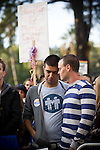 SACRAMENTO, CA - NOVEMBER 22:  Thomas Losa, left, and Travis Coble listen to speakers at a rally in support of gay marriage on the steps of the State Capitol in Sacramento, California November 22, 2008. People across the country continue to protest the passing of California State Proposition 8 which makes gay marriage in California illegal. (Photo by Max Whittaker/Getty Images)