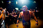 Lucha Libre AAA wrestler Silver King walks ringside at a match in Sacramento, CA March 28, 2009.