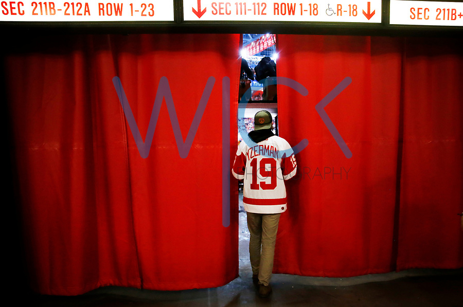 A Detroit Red Wings fan walks through the concourse during the game against the Montreal Canadiens at Joe Louis Arena in Detroit, Michigan on Saturday April 8, 2017. (Photo by Jared Wickerham/The Players Tribune)