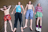 Olive, Lucas, Felix, Mitchell and Vita playing in the rain. The Barn. Bridgehampton, New York 2012